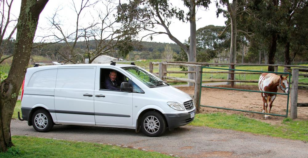 The Australian farrier Phillip Smailes in his van